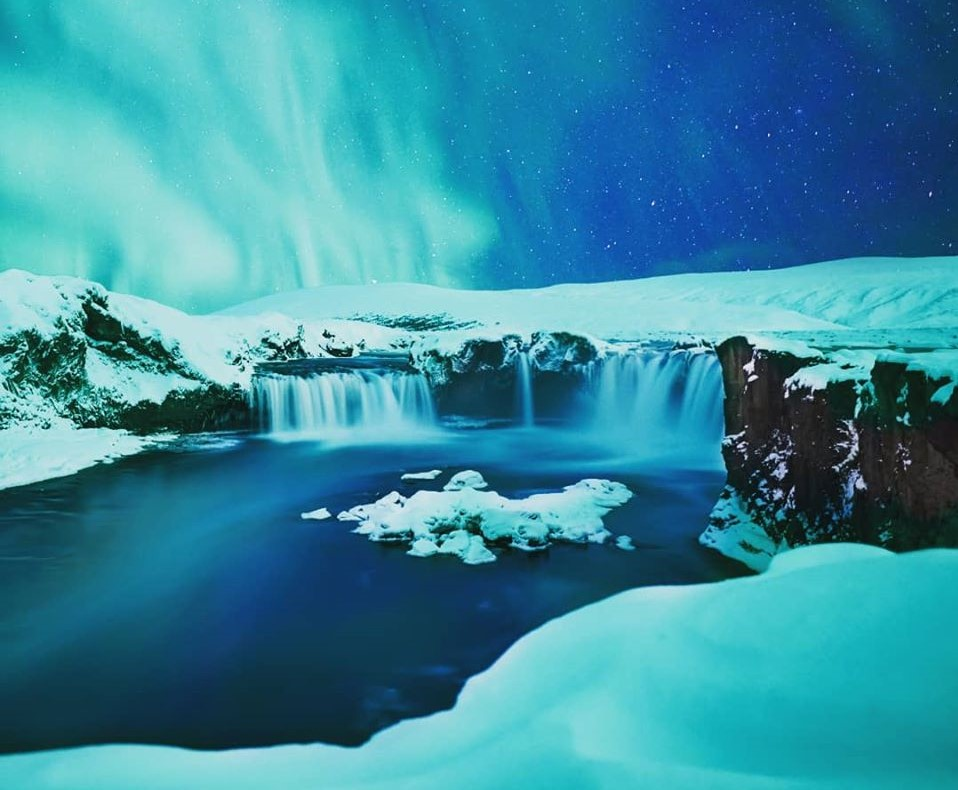 Godafoss waterfall bathed in Northern Lights